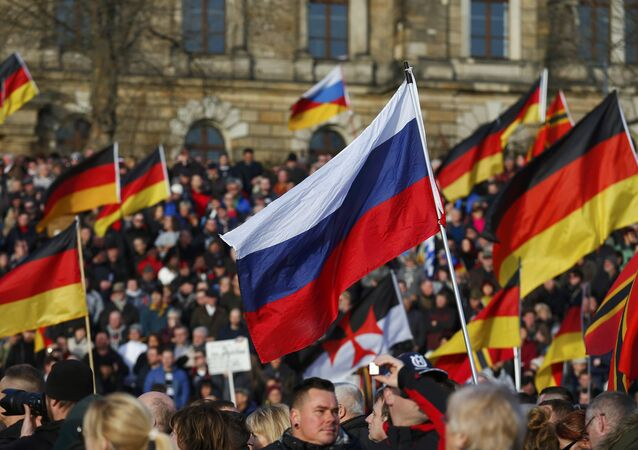 Supporters of the anti-Islam movement Patriotic Europeans Against the Islamisation of the West (PEGIDA) carry German and Russian flags during a demonstration in Dresden, Germany, February 6, 2016