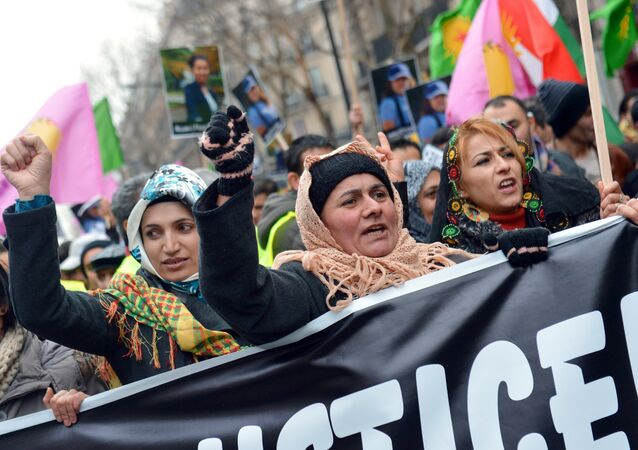 Women members of the Kurdish community take part in the annual rally of Kurds from all over Europe.file photo
