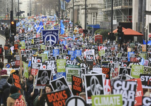 Protesters take part in a protest against the Trident nuclear missile system in London, February 27, 2016.