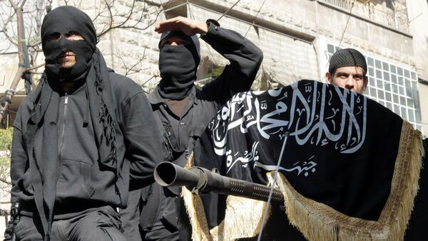 Members of jihadist group Al-Nusra Front take part in a parade calling for the establishment of an Islamic state in Syria, at the Bustan al-Qasr neighbourhood of Aleppo, on October 25, 2013 - Sputnik International