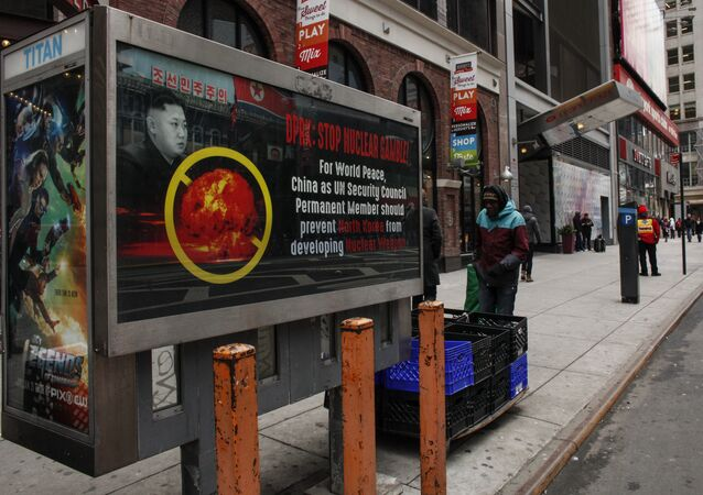 A poster ad that reads : DPRK: STOP NUCLEAR GAMBLE! is displayed on a street near Times Square in New York on February 9,2016