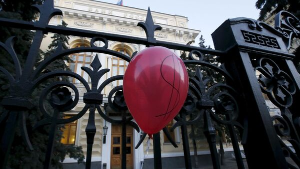 A balloon is seen during a rally of foreign currency mortgage holders near the Central Bank headquarters in central Moscow, Russia, February 8, 2016 - Sputnik International
