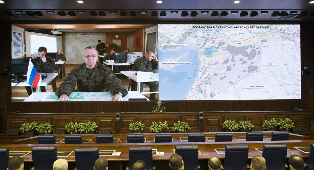 Lt.-Gen. Sergei Rudskoi of the Russian Military General Staff, background center, speaks to the media in Moscow, Russia, Saturday, Feb. 27, 2016