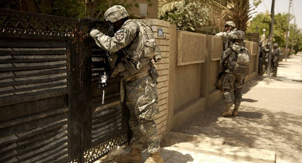 U.S. Army Soldiers look into the courtyard of a house. Iraq