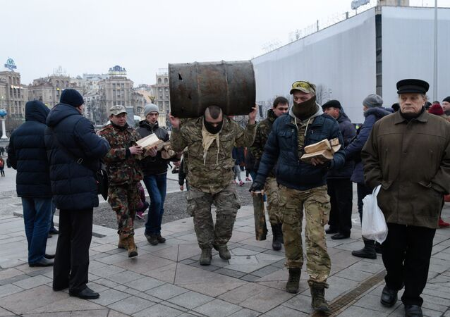 Participants of the People's Veche (Assembly) of radicals carry barrels and wood to make fire on Indepence Square in Kiev