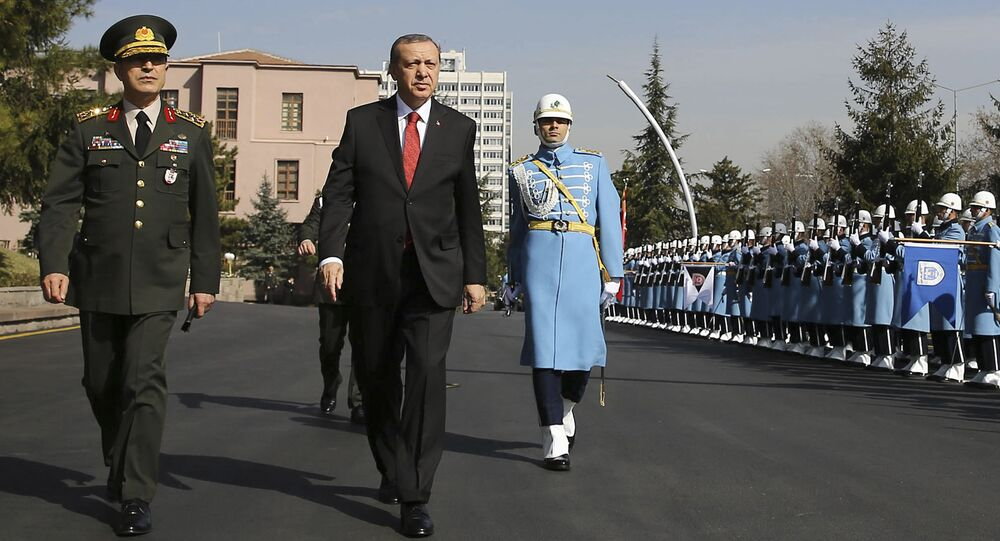 Turkish President Recep Tayyip Erdogan, centre, accompanied by Turkish Forces' Chief of Staff Gen. Hulusi Akar, left, reviews a honour guard Thursday Feb. 18, 2016