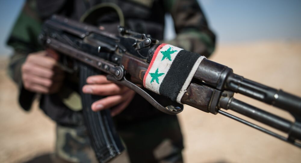 A soldier of the Syrian Arab Army (SAA) near the town of Mhin, Syria