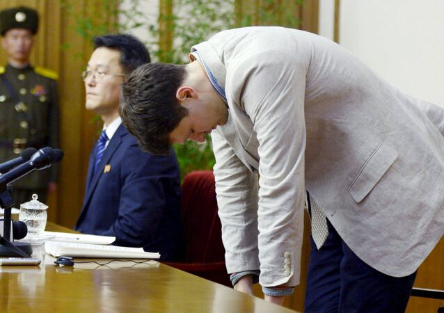 Otto Frederick Warmbier (R), a University of Virginia student who has been detained in North Korea since early January, bows during a new conference in Pyongyang, North Korea, in this photo released by Kyodo February 29, 2016