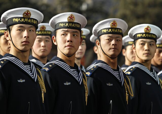 Members of a Chinese Navy honour guard wait for US Secretary of Defense Robert Gates to review the troops during a welcoming ceremony at Bayi Building in Beijing on January 10, 2011