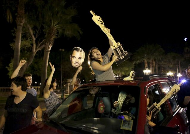 Fans celebrate the win by Alejandro Inarritu for Best Director and Leonardo DiCaprio for Best Actor in his leading role for the movie The Revenant at the 88th Academy Awards in Hollywood, in Monterrey, February 29, 2016