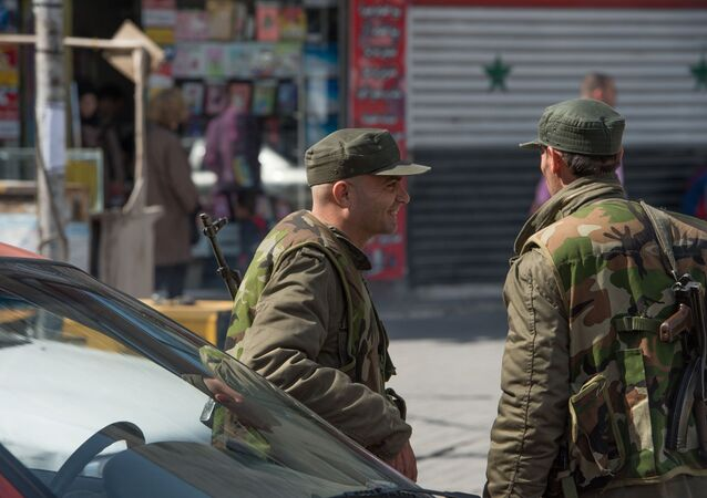 Syrian soldier on a street of Damascus on the first day of truce
