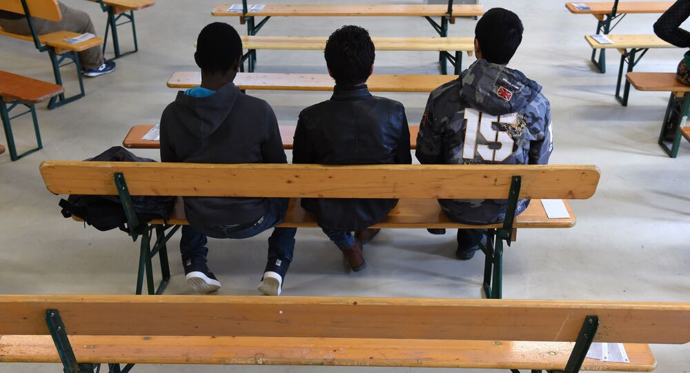 Migrants wait for the start of the rights education lessons for refugees and asylum seekers