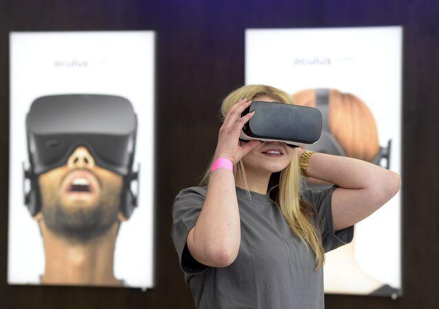 A woman uses a virtual reality device.