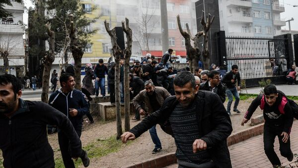 People disperse as Turkish police fire tear gas in Diyarbakir on February 27, 2016 during a demonstration against government-imposed curfews on areas of eastern Turkey - Sputnik International