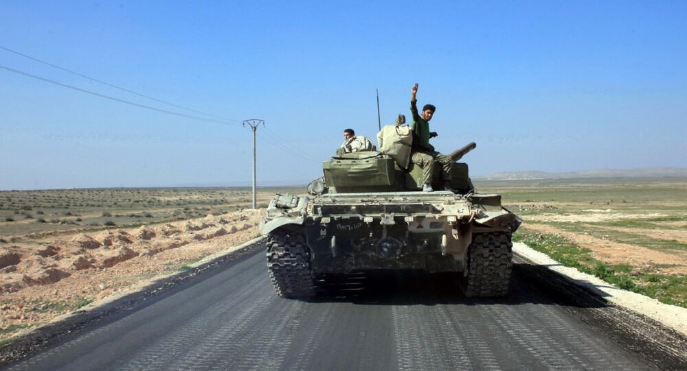 Syrian pro-government forces advance on a road through the town of Khanasser, which is the sole link between government-held areas in and around Aleppo and those in the rest of the country, after they reportedly recaptured it from Islamic State (IS) group fighters, on February 29, 2016.