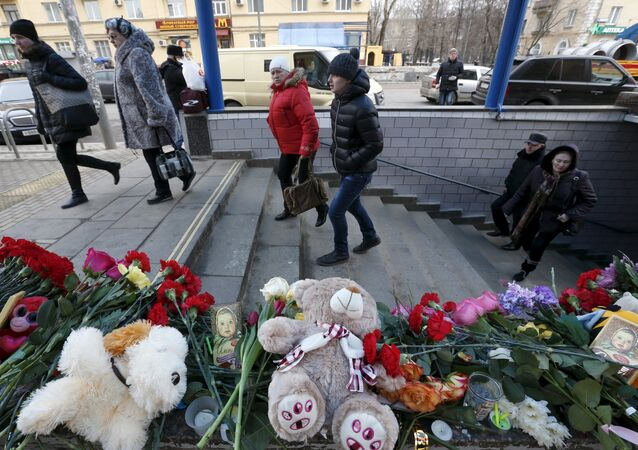 Flowers, toys and other items are placed to commemorate recently murdered child at the entrance to the Oktyabrskoye Pole metro station in Moscow, Russia, March 1, 2016.