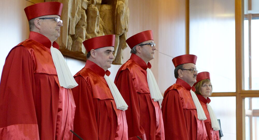 Judges of the second senate at the German Federal Constitutional Court (Bundesverfassungsgericht) in Karlsruhe, southern Germany open a hearing on a possible ban of the far-right NPD party on March 1, 2016.