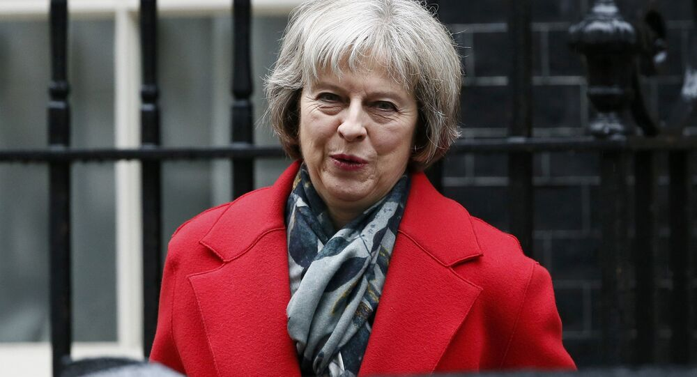 Britain's Home Secretary Theresa May leaves Number 10 Downing Street after attending a cabinet meeting in London, Britain March 1, 2016.