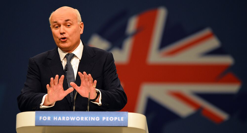 Iain Duncan-Smith, Secretary of State for Work and Pensions, addresses delegates at the annual Conservative Party Conference in Manchester, north-west England on October 1, 2013.