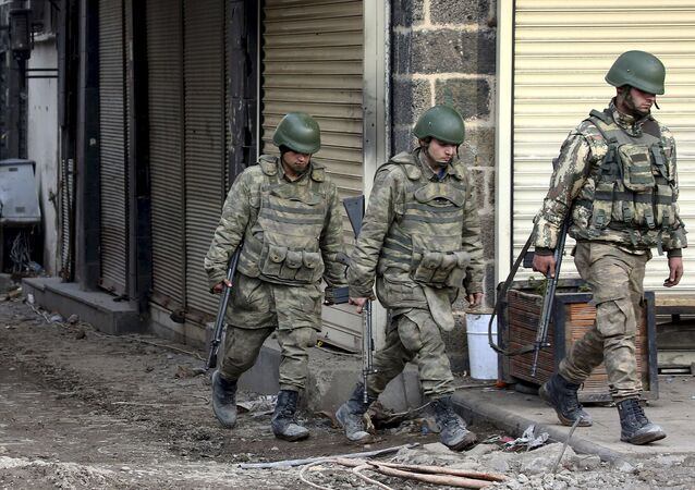 Turkish soldiers patrol in Sur district, which is partially under curfew, in the Kurdish-dominated southeastern city of Diyarbakir
