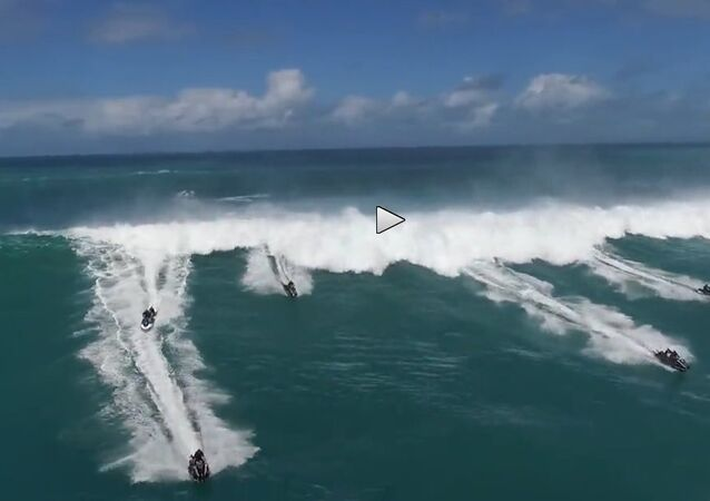Jet Skis Speed Away from Wave