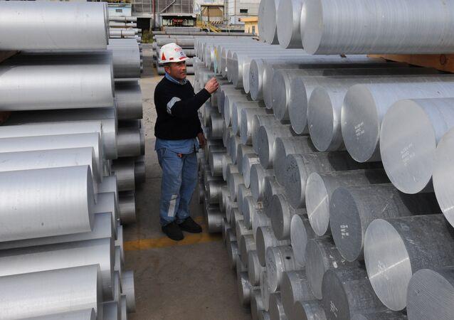 Aworker checks aluminium bars on February 15, 2010 at the US aluminium company Alcoa's plant in Portovesme. (File)