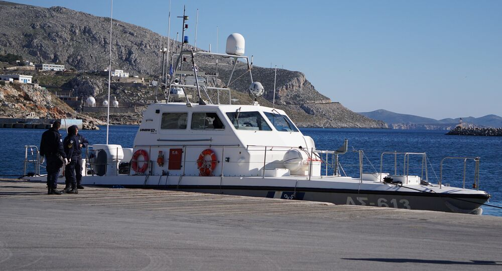 Greek Coast guard officers stand outside their vessel at the port of Kalymnos island. (File)