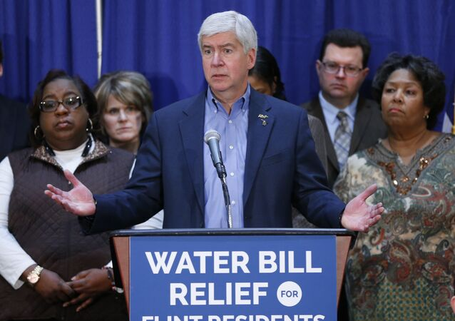 In this Feb. 26, 2016 photo, Gov. Rick Snyder speaks after attending a Flint Water Interagency Coordinating Committee meeting in Flint, Mich. The state of Michigan restricted Flint from switching water sources last April unless it got approval from Gov. Rick Snyder's administration under the terms of a $7 million loan needed to help transition the city from state management, according to a document released Wednesday, March 2, 2016.
