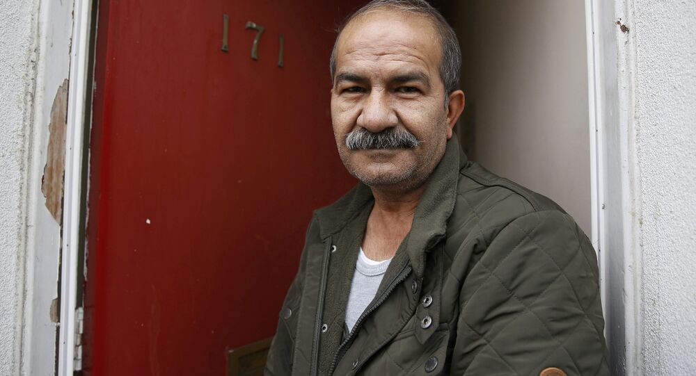 Iranian asylum seeker Mohammed Bagher Beyzevi poses for a photograph outside his home on Union Street in Middlesbrough, northern Britain, in this file photograph dated January 20, 2016.
