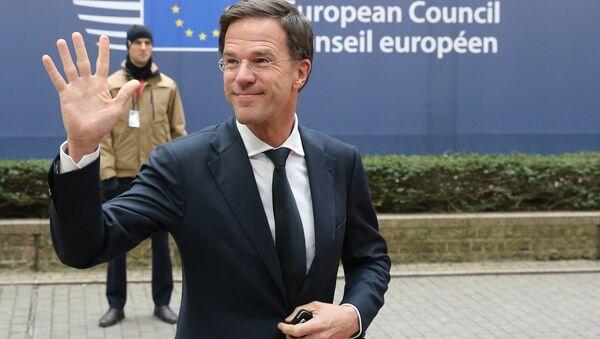 Dutch Prime Minister Mark Rutte waves as he arrives for an EU summit at the EU Council building in Brussels on Thursday, Feb. 18, 2016. - Sputnik International