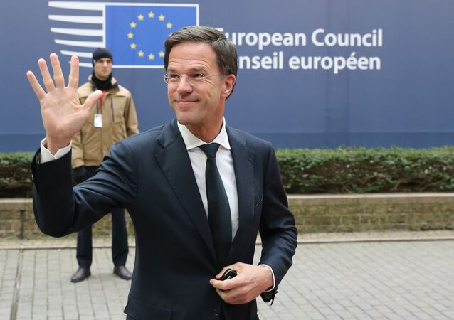 Dutch Prime Minister Mark Rutte waves as he arrives for an EU summit at the EU Council building in Brussels on Thursday, Feb. 18, 2016.