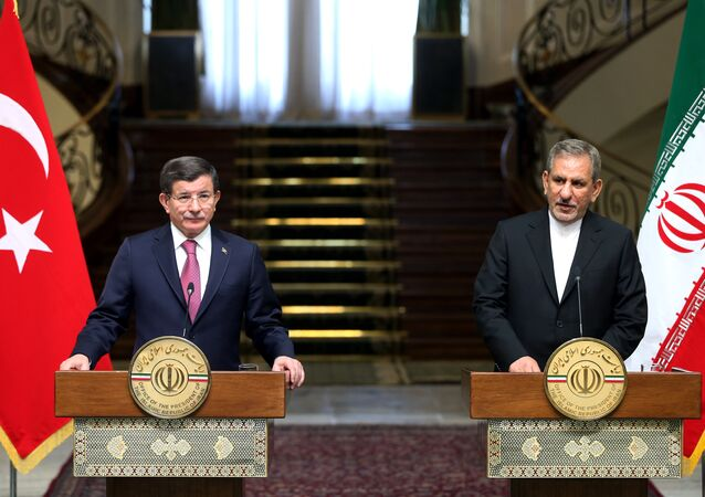 Iranian Vice-President Eshagh Jahangiri, right, speaks with media in a joint press conference with Turkish Prime Minister Ahmet Davutoglu after their meeting at the Saadabad Palace in Tehran, Iran, Saturday, March 5, 2016