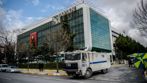 A water cannon of the Turkish police is parked in front of the headquarters of Turkish daily newspaper Zaman in Istanbul on March 5, 2016, after Turkish authorities seized the headquarters in a midnight raid - Sputnik International