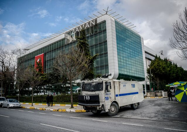 A water cannon of the Turkish police is parked in front of the headquarters of Turkish daily newspaper Zaman in Istanbul on March 5, 2016, after Turkish authorities seized the headquarters in a midnight raid