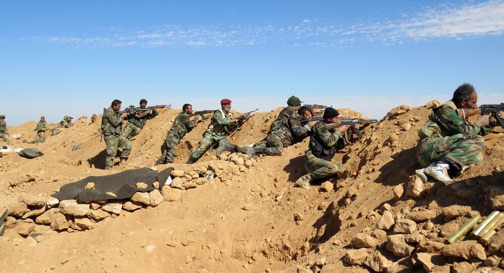 Syrian army soldiers take positions on the outskirts of Syria's Raqa region on February 19, 2016