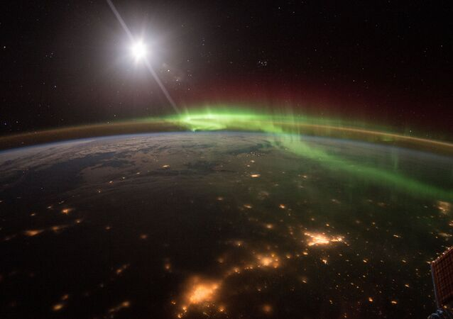 NASA astronaut Scott Kelly took this majestic image of the Earth at night highlighting the green and red hues of an Aurora