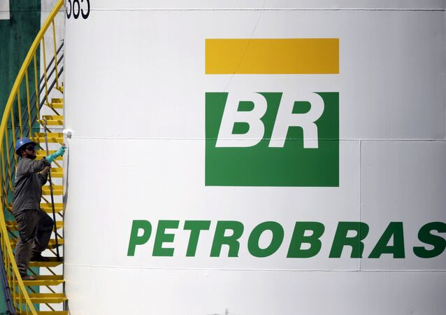A worker paints a tank of Brazil's state-run Petrobras oil company in Brasilia, Brazil in this September 30, 2015 file photo