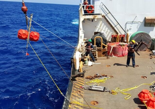 Hauling up hydrophone during the Challenger Deep mission in 2015