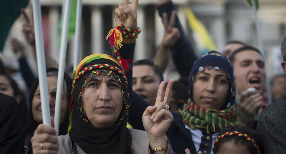 Protesters gesture the peace sign during a demonstration in Trafalgar Square in London on November 1, 2014 in a show of solidarity with Kurdish resistance to Islamic State