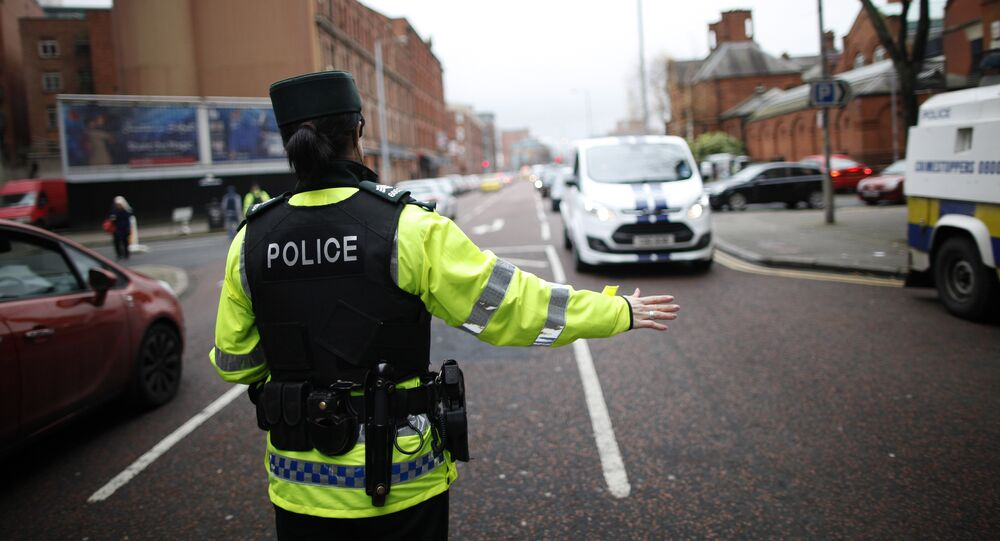 A police officer checks vehicles in South Belfast, Northern Ireland. File photo