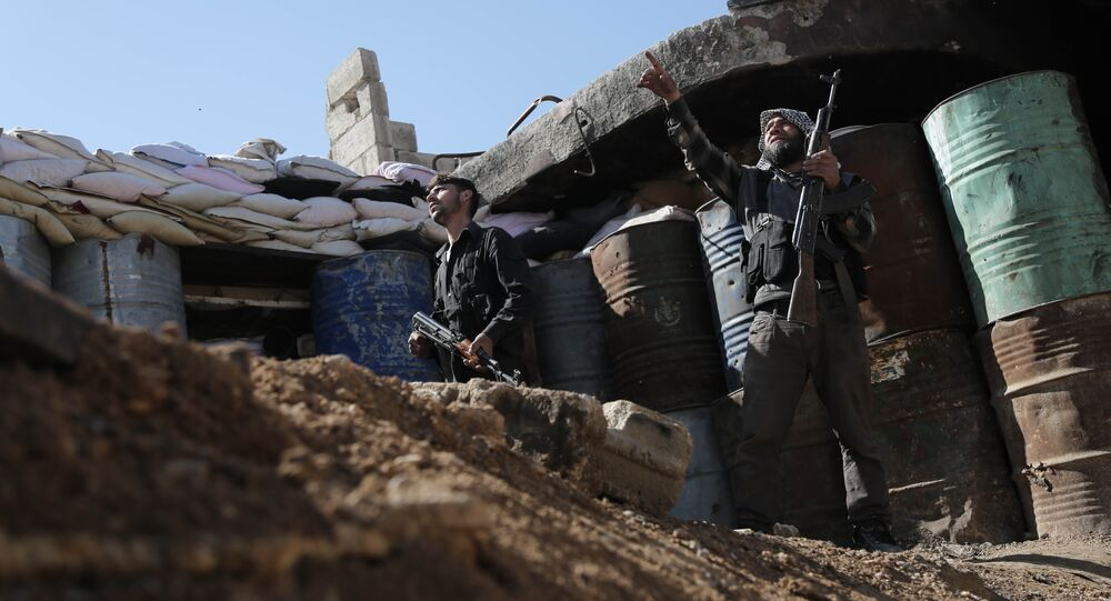 Syrian rebel fighters from the Failaq al-Rahman brigade opposed to the regime man a position in the town of Arbin in the eastern Ghouta region on the outskirts of the capital Damascus on February 26, 2016