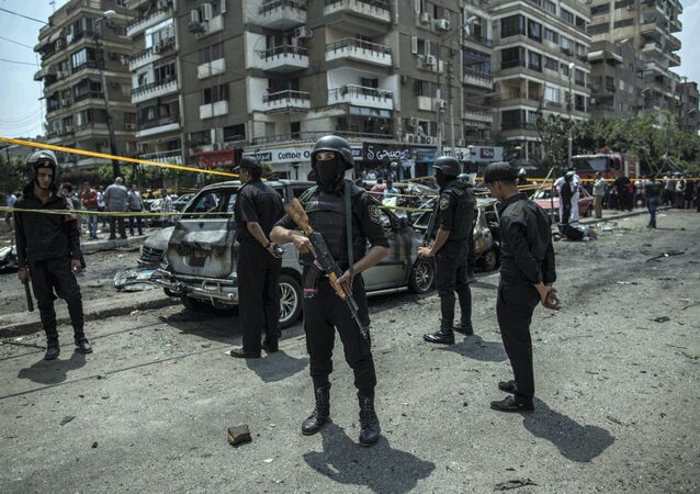 FILE -- In this June 29, 2015 file photo, Egyptian policemen stand guard at the site of a bombing that killed Egypt's top prosecutor, Hisham Barakat, who oversaw cases against thousands of Islamists, in Cairo, Egypt