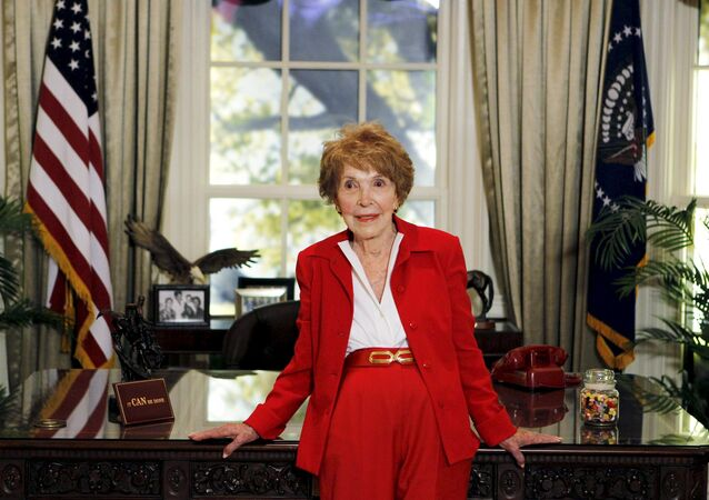 Former U.S. first lady Nancy Reagan waits to greet Republican presidential candidates in a replica of the Oval Office at the Ronald Reagan Presidential Library in Simi Valley, California in this September 7, 2011 file photo