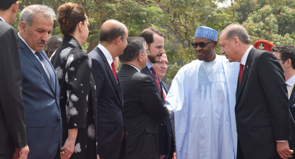 Turkey's President Recep Tayyip Erdogan, right, introduces Turkish businessmen to Nigerian President Muhammadu Buhari, during an official visit at the Presidential Palace in Abuja, Nigeria, Wednesday, March 2, 2016