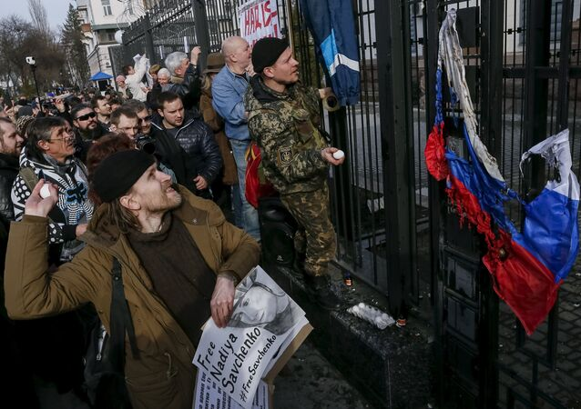 Protesters throw eggs towards a building of the Russian embassy during a rally demanding the liberation of Ukrainian army pilot Nadezhda Savchenko by Russia, in Kiev, Ukraine, March 6, 2016