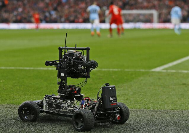 A wheeled remote camera films during the English League Cup final soccer match between Liverpool and Manchester City at Wembley stadium in London, Sunday, Feb. 28, 2016