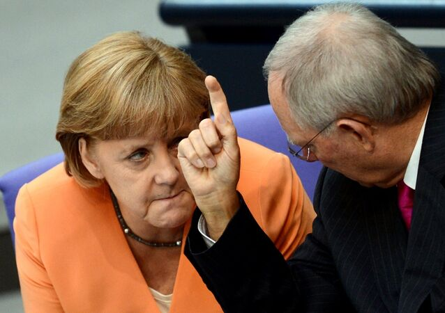 German Chancellor Angela Merkel (L) and German Finance Minister Wolfgang Schaeuble speaks during a session of the Bundestag, the lower house of parliament in Berlin on July 19, 2012.