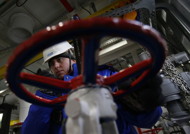 A worker of Russian gas and oil giant Gazprom works on February 18, 2015 in Novoprtovskoye oil and gas condensates oilfield at Cape Kamenny in the Gulf of Ob shore line in the south-east of a peninsular in the Yamalo-Nenets Autonomous District, 250 km north of the town of Nadym, northern Russia