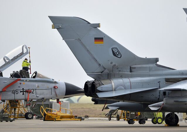 A technician works on a German Tornado jet at the air base in Incirlik, Turkey, on January 21, 2016