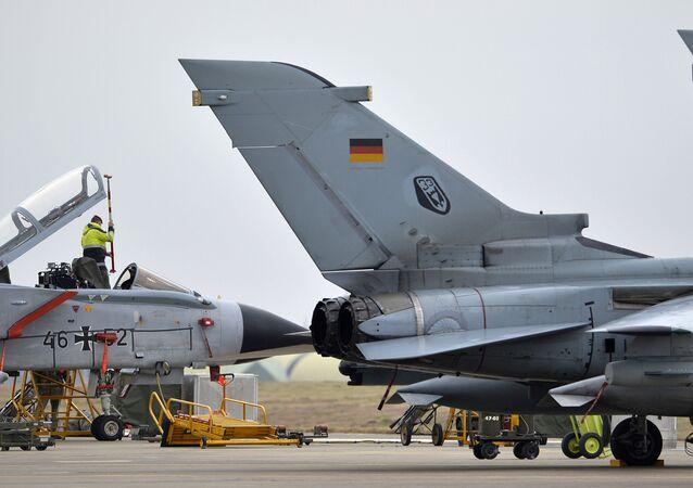 A technician works on a German Tornado jet at the airbase in Incirlik, Turkey, on January 21, 2016